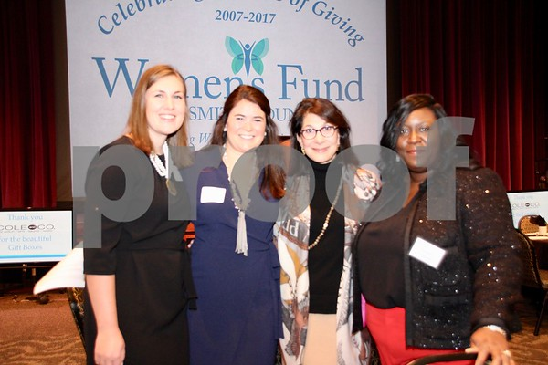 (L) Erica Hall and (2nd from L) Camille Moughon both from Akola Project with (3rd from L) Luct Carr and (R) Karen Tidwell