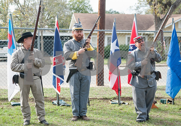 Sons of Confederate Veterans members Charles Plumley, Robert Dismukes, and Mark Bassett give a rifle demonstration at the annual Heritage Syrup Festival Saturday Nov. 14, 2015 in Henderson, Texas. The celebrates the tradition of ribbon cane syrup and features a syrup making demonstration utilizing the Depot Museum's antique mule powered equipment. The festival also features basket weaving,  blacksmithing, folk singers, vendors and square dancing.  (Sarah A. Miller/Tyler Morning Telegraph)
