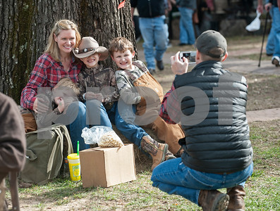 Bryan Yeates of Colmesneil takes a photo of his wife Katie Yeates and their sons J.R. Years, 5, Sam Yeates, 7, and Hank Yeates, 7, at the annual Heritage Syrup Festival Saturday Nov. 14, 2015 in Henderson, Texas. The celebrates the tradition of ribbon cane syrup and features a syrup making demonstration utilizing the Depot Museum's antique mule powered equipment. The festival also features basket weaving,  blacksmithing, folk singers, vendors and square dancing.  (Sarah A. Miller/Tyler Morning Telegraph)