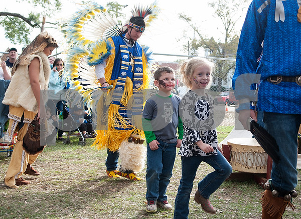 Cain Temple, 4, of Henderson and Cloy Atkinson, 7, of Henderson, dance with members of Tejas Lodge Order of the Arrow at the annual Heritage Syrup Festival Saturday Nov. 14, 2015 in Henderson, Texas. The celebrates the tradition of ribbon cane syrup and features a syrup making demonstration utilizing the Depot Museum's antique mule powered equipment. The festival also features basket weaving,  blacksmithing, folk singers, vendors and square dancing.  (Sarah A. Miller/Tyler Morning Telegraph)