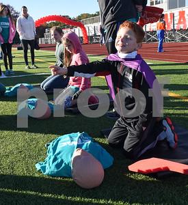 Cadyn Gipson, 8, leans CPR at Tyler Heart Walk benefiting the American Heart Association Saturday Nov. 19, 2016 at Robert E. Lee High School.  (Sarah A. Miller/Tyler Morning Telegraph)