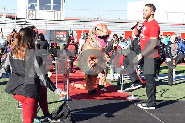 Casey Parker of XTC Fitness leads a warm-up at the Tyler Heart Walk benefiting the American Heart Association Saturday Nov. 19, 2016 at Robert E. Lee High School.  (Sarah A. Miller/Tyler Morning Telegraph)