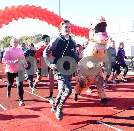 Runners and a T-Rex lead the start of the Tyler Heart Walk benefiting the American Heart Association Saturday Nov. 19, 2016 at Robert E. Lee High School.  (Sarah A. Miller/Tyler Morning Telegraph)