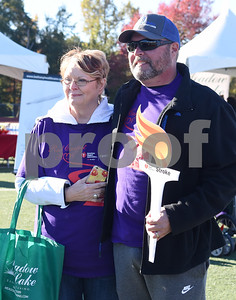 Rose Elia stands next to John Elia as he is honored at the Tyler Heart Walk as this year's Heart Walk Survivor Saturday Nov. 19, 2016 at Robert E. Lee High School.  (Sarah A. Miller/Tyler Morning Telegraph)