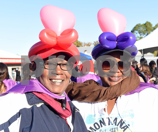 Stella Johnson and Pamela Johnson of Bullard wear heart shaped balloon hats at Tyler Heart Walk benefiting the American Heart Association Saturday Nov. 19, 2016 at Robert E. Lee High School.  (Sarah A. Miller/Tyler Morning Telegraph)