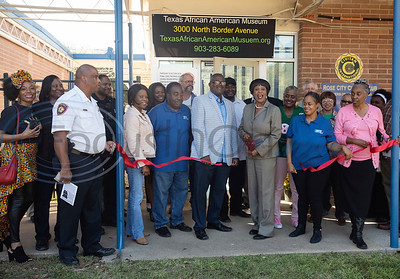 Gloria Washington, executive director of the Texas African American Museum, cuts the ribbon for the opening of the museum in Tyler on Friday Nov. 2, 2018. The museum is a branch of the Empowerment Community Development Corporation.   (Sarah A. Miller/Tyler Morning Telegraph)