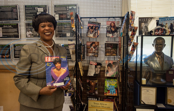 Gloria Washington, executive director of the Texas African American Museum, holds a magazine from her collection at the museum in Tyler on Friday Nov. 2, 2018. The museum is a branch of the Empowerment Community Development Corporation.   (Sarah A. Miller/Tyler Morning Telegraph)