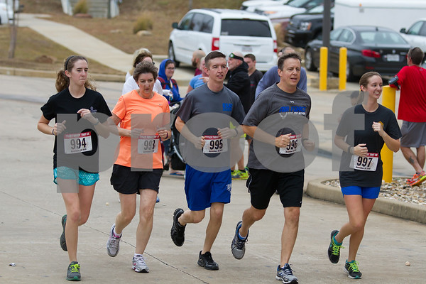 Running is a Family Tradition.  Here the Taylor Family, Tricia, Lezlie,Brennan,Galen, and Brooke Taylor take part in the 13th Annual Tyler Turkey Trot on Thurday November 26th. / photo by John Murphy