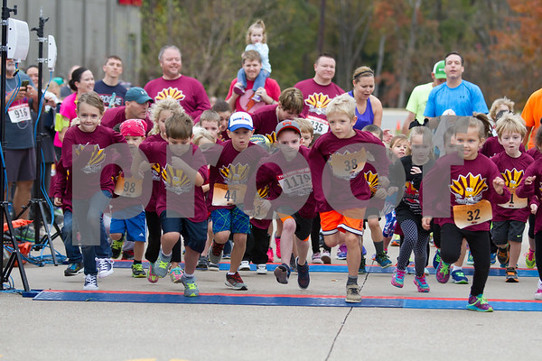 The 13th Annual Trukey Trot is a family friendly event.  Here a group of young runners take part in the Kids Dash before the start of the 5K race.  Photo by John Murphy