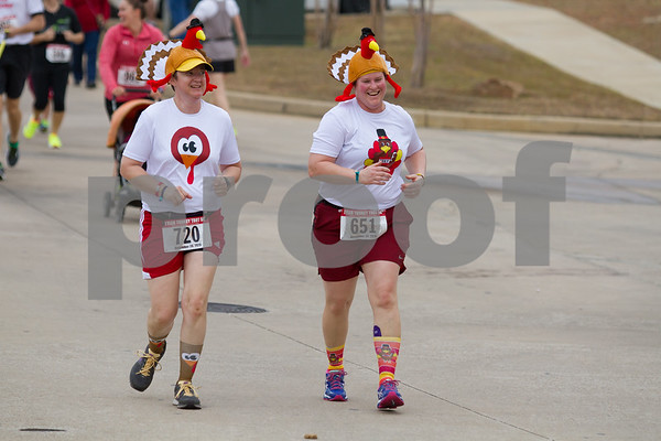 Pam Myers and Stacy McGehee take part in the 13th nnual Tyler Trukey Trot. / photo by John Murphy