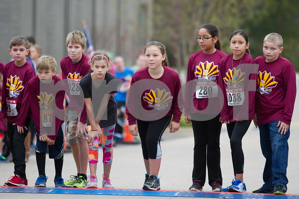 The 13th Annual Tyler Turkery Trot is a family friendly event.  Here a group of 11 and 12 year olds prepare for the Kids Dash before the start of the 5K race. / photo bu John Murphy