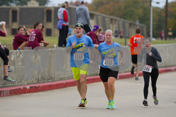 Dr. Joesph Zasik and Karen Zasik of Tyler take part in the 13th Annual Tyler Turkey Trot. / photo by John Murphy