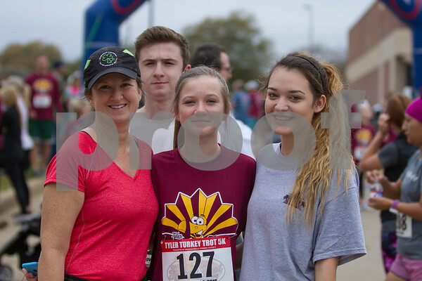 Thanksgiving Family Traditions. Kristen Brown of Tyler and her family, Collin, Mary Esten Brown and Ana Guzman take part in the 13th Annual Tyler Trukey Trot.  The Borwn family takes part in this event every year. / photo by John Murphy