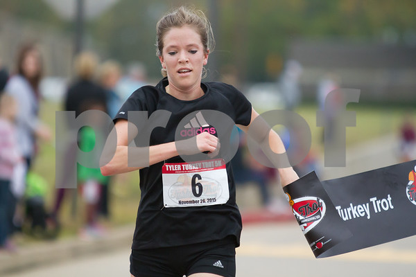 Mia Behm, with a time of 17:29, was the first female runner to finish the 13th Auunal Tyler Turkey Trot / photo by John Murphy