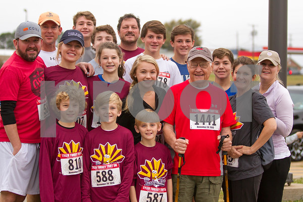 Family Traditions , Bob Legg of Jacksonville along with 16 members of his family take part in the 13th Annual Tyler Turkey Trot on Thursday November 26th.  This is an annual event for the Legg Family. / photo by John Murphy