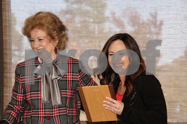 Sheryl Coffey (L) presents MADD's award to Laura Gonzales (R)