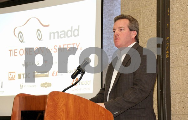 Ron Upshaw accepting MADD's recognition award on behalf of his father, Dick Upshaw.