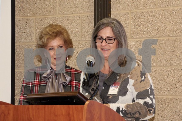 Sheryl Coffey (L) presents two MADD awards toJerri Pendarvis (R)