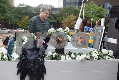 Byron Nelson of Tyler looks at the communal alter during the Dia de los Muertos celebration in downtown Tyler Saturday Nov. 5, 2016.   (Sarah A. Miller/Tyler Morning Telegraph)