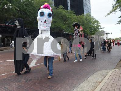 A Dia de los Muertos procession walks the square  in downtown Tyler Saturday Nov. 5, 2016.   (Sarah A. Miller/Tyler Morning Telegraph)