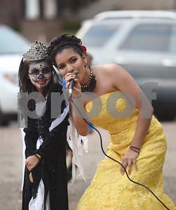 Singer Maria Cristina Bravo takes a photo with Alexia Arroyo, 8, during the Dia de los Muertos celebration in downtown Tyler Saturday Nov. 5, 2016.   (Sarah A. Miller/Tyler Morning Telegraph)