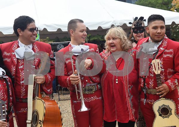 Cecilia Rodriguez-Bush thanks the mariachi band Mariachi Nochistlan for performing at her Dia de los Muertos celebration in downtown Tyler Saturday Nov. 5, 2016.   (Sarah A. Miller/Tyler Morning Telegraph)