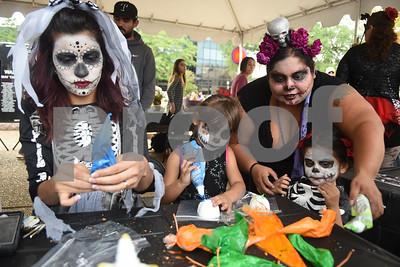 Sasha Arroyo, Juniper Parson, 3, Josey Parson, 5, and Joanna Parson decoate sugar skulls at her Dia de los Muertos celebration in downtown Tyler Saturday Nov. 5, 2016.   (Sarah A. Miller/Tyler Morning Telegraph)