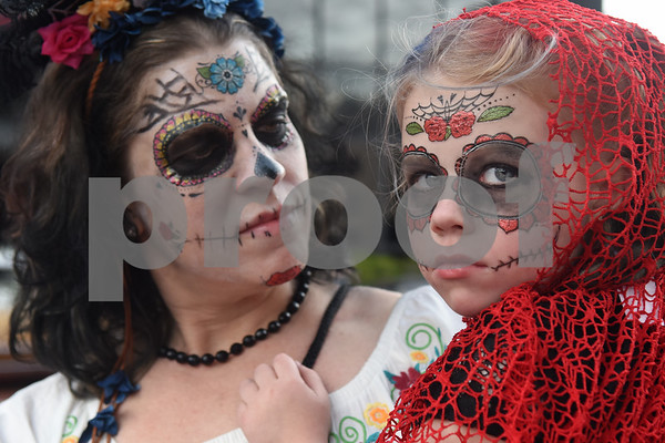 Katy Collins of Tyler and her daughter Rachel Collins, 5, wear costumes during the Dia de los Muertos celebration in downtown Tyler Saturday Nov. 5, 2016.   (Sarah A. Miller/Tyler Morning Telegraph)