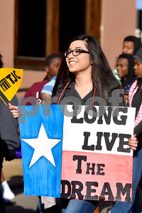 A Tyler Junior College student marches during the Martin Luther King Jr. Day 32nd annual Interfaith Community Program in downtown Tyler, Texas, on Monday, Jan. 15, 2018. Hundreds of people marched in a parade and attended the program honoring Dr. King, where speakers talked about the need in continuing to strive for justice and equality. (Chelsea Purgahn/Tyler Morning Telegraph)
