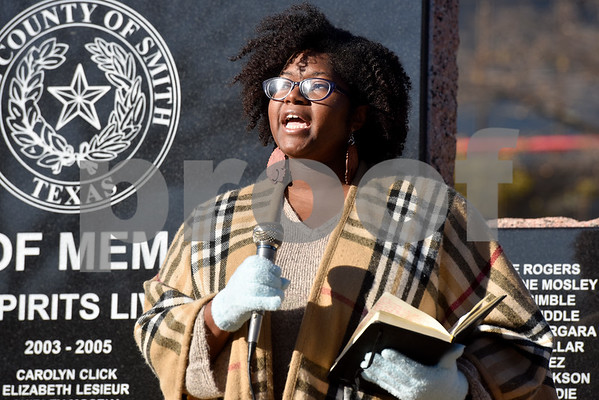 Jasmine Lewis recites a poem during the Martin Luther King Jr. Day 32nd annual Interfaith Community Program at T.B. Butler Fountain Plaza in Tyler, Texas, on Monday, Jan. 15, 2018. Hundreds of people marched in a parade and attended the program honoring Dr. King, where speakers talked about the need in continuing to strive for justice and equality. (Chelsea Purgahn/Tyler Morning Telegraph)