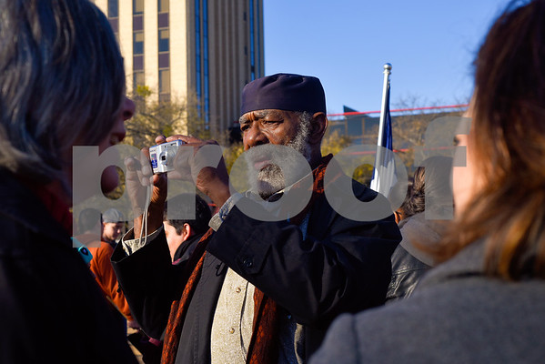 Wolf Ray takes a picture during the Martin Luther King Jr. Day 32nd annual Interfaith Community Program at T.B. Butler Fountain Plaza in Tyler, Texas, on Monday, Jan. 15, 2018. Hundreds of people marched in a parade and attended the program honoring Dr. King, where speakers talked about the need in continuing to strive for justice and equality. (Chelsea Purgahn/Tyler Morning Telegraph)