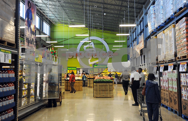 photo by Sarah A. Miller/Tyler Morning Telegraph  Customers shop on the opening day of the newest and biggest Super 1 Foods grocery store located at 105 E. Gentry Parkway in Tyler Wednesday morning.