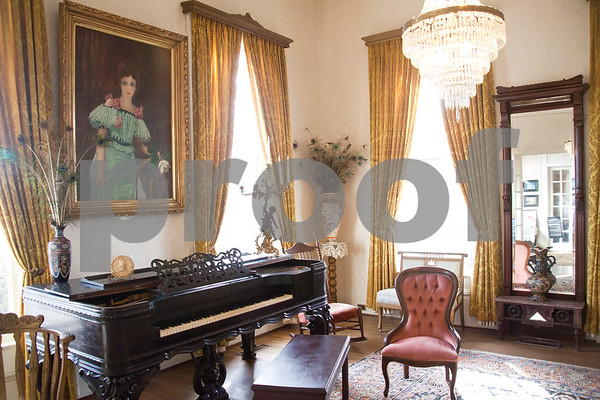 """Photo by Haylee Bazil/Staff Photographer.""""The Gold Room,"""" the formal south parlor at the Goodman Mansion. The portrait above the 1873 Mathashek square grand piano is of Marjorie Goodman, niece of Dr. Samuel Goodman Senior. Will Parr, owner of Deaf Chef Catering Services has written The Family Book of Samuel Goodman Senior, to help provide funds to aid in the preservation of the Goodman mansion and family heritage. In June 2014, Mr. Parr started the process of writing the book by investigating the Goodman history going to the Courthouse Annex for records and the Tyler Public Library, reading Sallie G. LeGrand's diaries at the Smith County Society Museum, and an ancestry website. The book is designed in scrapbook style and displays pictures of  the Goodman family, and depicts their family tree. The book may be purchased at the Goodman Museum."""