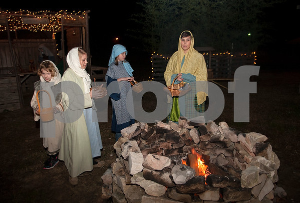 Kylie Fields, 6, Baylee Boykin, 10, Kryslynn Miekow, 9, and Vickie Bussell play beggars and peasants in the streets of Bethlehem at West Lake Baptist Church in Chandler Wednesday Dec. 9, 2015 during rehearsal for Night in Bethlehem. Night in Bethlehem is a live reenactment depicting the city of Bethlehem the night of our Jesus' birth.   (Sarah A. Miller/Tyler Morning Telegraph)