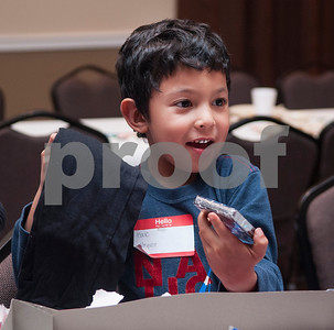 Isaac Vasquez opens a present during a special Christmas dinner and gift event for Jackson Elementary School students at Friendly Baptist Church in Tyler Dec. 11, 2015. Students from the church's youth group raised the money for the event which benefitted 45 children from Jackson Elementary. Youth group members also cooked the meal. Jackson Elementary students were nominated by their teachers and school counselors to attend the event.   (Sarah A. Miller/Tyler Morning Telegraph)