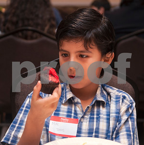 Michael Torres, 10, eats a cupcake during a special Christmas dinner and gift event for Jackson Elementary School students at Friendly Baptist Church in Tyler Dec. 11, 2015. Students from the church's youth group raised the money for the event which benefitted 45 children from Jackson Elementary. Youth group members also cooked the meal. Jackson Elementary students were nominated by their teachers and school counselors to attend the event.   (Sarah A. Miller/Tyler Morning Telegraph)