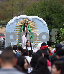 A girl portrays the Virgin Mary during a procession in Tyler held by St. Peter Claver Catholic Church in Tyler Sunday Dec. 11, 2016 to celebrate the feast day for Our Lady of Guadalupe. Our Lady of Guadalupe celebrates the image of the Virgin Mary that appeared on a piece of cloth work by an Aztec Indian named Juan Diego on December 9, 1531, in Mexico.  (Sarah A. Miller/Tyler Morning Telegraph)