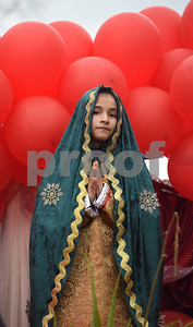 Patricia Munoz, 11, portrays the Virgin Mary during a procession in Tyler held by St. Peter Claver Catholic Church in Tyler Sunday Dec. 11, 2016 to celebrate the feast day for Our Lady of Guadalupe. Our Lady of Guadalupe celebrates the image of the Virgin Mary that appeared on a piece of cloth work by an Aztec Indian named Juan Diego on December 9, 1531, in Mexico.  (Sarah A. Miller/Tyler Morning Telegraph)