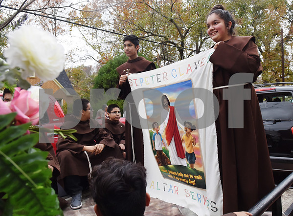 Alter servers Jovani Montero, 14, and Jasmine Rojas, 14, ride on a float during a procession in Tyler held by St. Peter Claver Catholic Church in Tyler Sunday Dec. 11, 2016 to celebrate the feast day for Our Lady of Guadalupe. Our Lady of Guadalupe celebrates the image of the Virgin Mary that appeared on a piece of cloth work by an Aztec Indian named Juan Diego on December 9, 1531, in Mexico.  (Sarah A. Miller/Tyler Morning Telegraph)