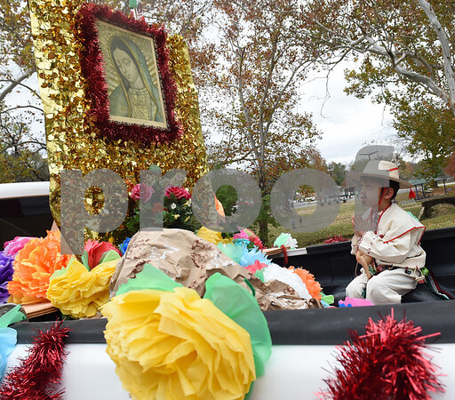 Carlos Daniel Carreno, 6, dresses as Juan Diego as he rides on a float during a procession in Tyler held by St. Peter Claver Catholic Church in Tyler Sunday Dec. 11, 2016 to celebrate the feast day for Our Lady of Guadalupe. Our Lady of Guadalupe celebrates the image of the Virgin Mary that appeared on a piece of cloth work by an Aztec Indian named Juan Diego on December 9, 1531, in Mexico.  (Sarah A. Miller/Tyler Morning Telegraph)