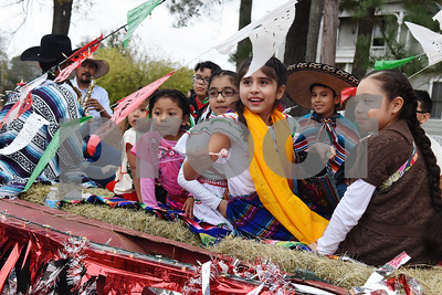 Children throw candy from a float during a procession in Tyler held by St. Peter Claver Catholic Church in Tyler Sunday Dec. 11, 2016 to celebrate the feast day for Our Lady of Guadalupe. Our Lady of Guadalupe celebrates the image of the Virgin Mary that appeared on a piece of cloth work by an Aztec Indian named Juan Diego on December 9, 1531, in Mexico.  (Sarah A. Miller/Tyler Morning Telegraph)