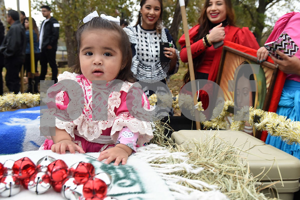 Adele Ruiz, 1, rides on a float during a procession in Tyler held by St. Peter Claver Catholic Church in Tyler Sunday Dec. 11, 2016 to celebrate the feast day for Our Lady of Guadalupe. Our Lady of Guadalupe celebrates the image of the Virgin Mary that appeared on a piece of cloth work by an Aztec Indian named Juan Diego on December 9, 1531, in Mexico.  (Sarah A. Miller/Tyler Morning Telegraph)