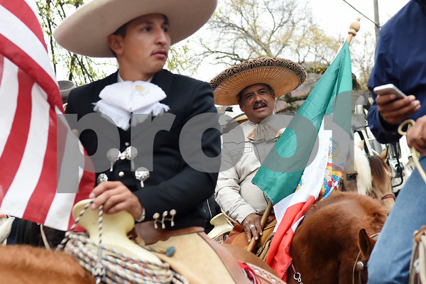 Emmanuel Ruiz carries the United States flag on horseback and Feliciano Mitchell carries the Mexican flag during a procession in Tyler held by St. Peter Claver Catholic Church in Tyler Sunday Dec. 11, 2016 to celebrate the feast day for Our Lady of Guadalupe. Our Lady of Guadalupe celebrates the image of the Virgin Mary that appeared on a piece of cloth work by an Aztec Indian named Juan Diego on December 9, 1531, in Mexico.  (Sarah A. Miller/Tyler Morning Telegraph)