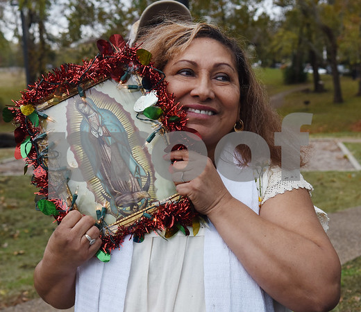 Bernardino S, Flores holds an image of Our Lady of Guadalupe during a procession in Tyler held by St. Peter Claver Catholic Church in Tyler Sunday Dec. 11, 2016 to celebrate the feast day for Our Lady of Guadalupe. Our Lady of Guadalupe celebrates the image of the Virgin Mary that appeared on a piece of cloth work by an Aztec Indian named Juan Diego on December 9, 1531, in Mexico.  (Sarah A. Miller/Tyler Morning Telegraph)