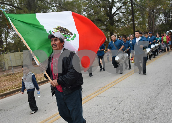 A man carries a Mexican flag during a procession in Tyler held by St. Peter Claver Catholic Church in Tyler Sunday Dec. 11, 2016 to celebrate the feast day for Our Lady of Guadalupe. Our Lady of Guadalupe celebrates the image of the Virgin Mary that appeared on a piece of cloth work by an Aztec Indian named Juan Diego on December 9, 1531, in Mexico.  (Sarah A. Miller/Tyler Morning Telegraph)
