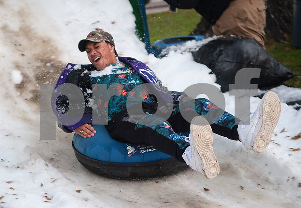 Tyler Junior College student LeDarious Grant of Marlin is hit by a snowball as he rides an inner tube down a snow hill during the 4th annual Winter Wonderland at Tyler Junior College Wednesday Dec. 2, 2015. The event featured a snow area, snow slide, bounce house, holiday games and free hot chocolate.   (Sarah A. Miller/Tyler Morning Telegraph)