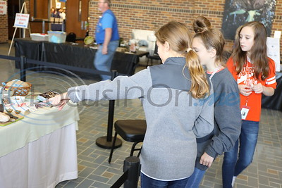 Students from Brook Hill School observe the special food table at the ET Gemstone & Jewelry Show.