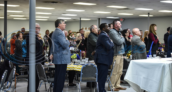 Guests stand for the Pledge of Allegiance at the Jacksonville Chamber 94th Annual Banquet. The Banquet was held at the Norman Activity Center on Friday, January 25 and recognizes several of the Chamber Board as well as an Outstanding Citizen of the Year. (Jessica T. Payne/Tyler Morning Telegraph)