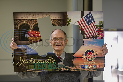 Outstanding Citizen of the Year recipient Sam Hopkins is all smiles while holding the Jacksonville Chamber of Commerce postcard frame at the Chamber's 94th Annual Banquet. The event took place at the Norman Activity Center on Friday, January 25. (Jessica T. Payne/Tyler Morning Telegraph)