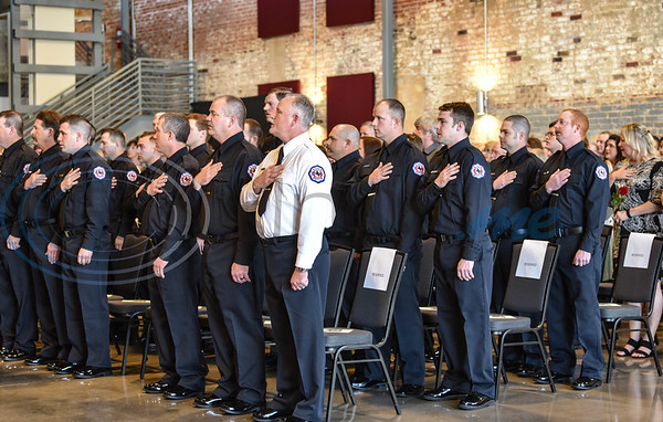 Firefighters stand for the National Anthem at the Athens Fire and Rescue Swearing In Ceremony. The event took place on Saturday, January 26 at The Texan. (Jessica T. Payne/Tyler Morning Telegraph)